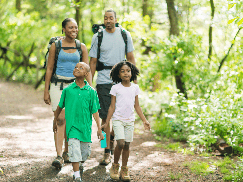 Family hiking and practicing mindfulness together